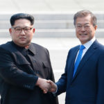 North Korean leader Kim Jong Un (L) shakes hands with President Moon Jae-in of South Korea