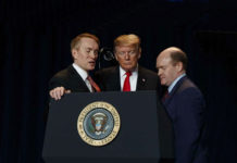 James Lankford and Sen. Chris Coons praying over President Donald Trump