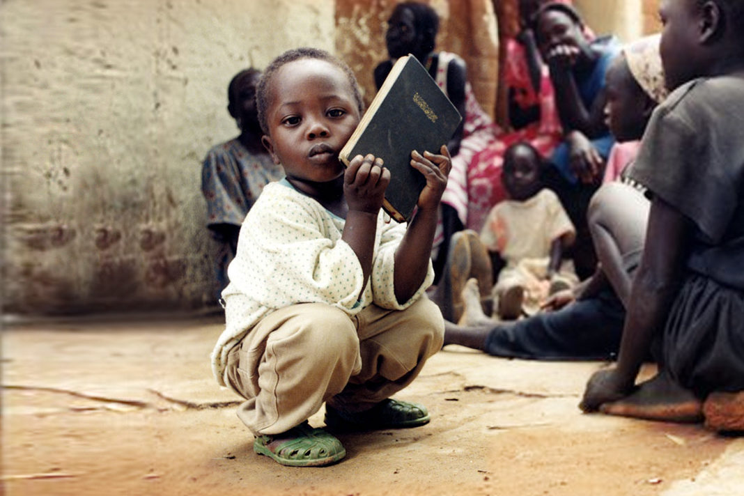 Little African boy with Bible