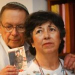 Miriam and Yoni Baumel hold a picture of their son Zachary Baumel, who went missing in 1982. (Flash90)