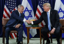 President Donald Trump shakes hands with Prime Minister Benjamin Netanyahu at the United Nations General Assembly