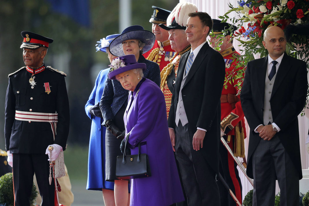 Britain's Queen Elizabeth, center, with Prime Minister Theresa May, top center, Foreign Secretary Jeremy Hunt, second right, and Home Secretary Sajid Javid, right, Oct. 23, 2018. (AP/Christopher Furlong)