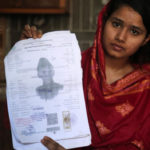 Mahek Liaqat, who married a Chinese national, shows her marriage certificate in Gujranwala, Pakistan.