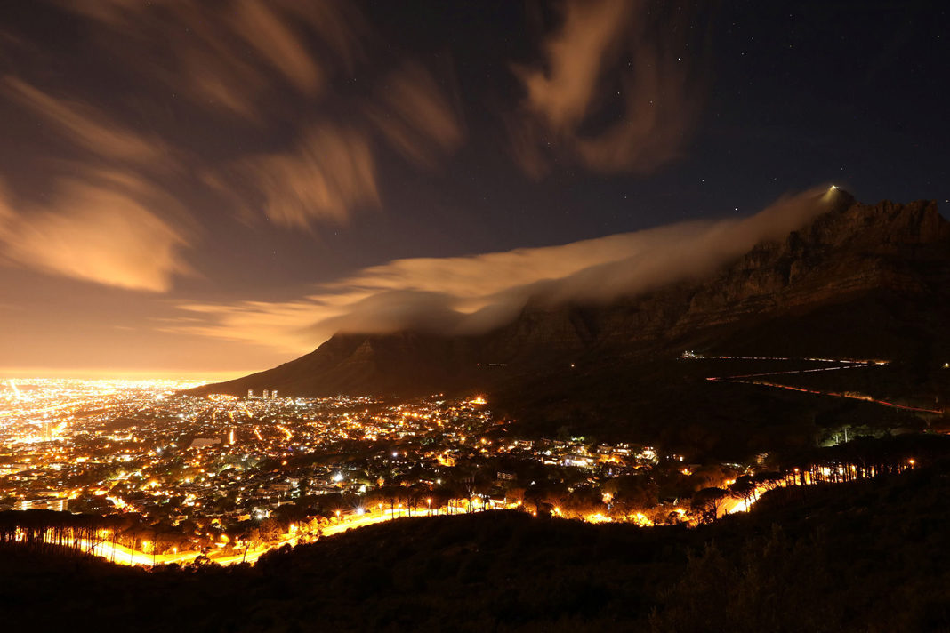 Clouds blow over Cape Town's iconic Table Mountain in Cape Town, South Africa.