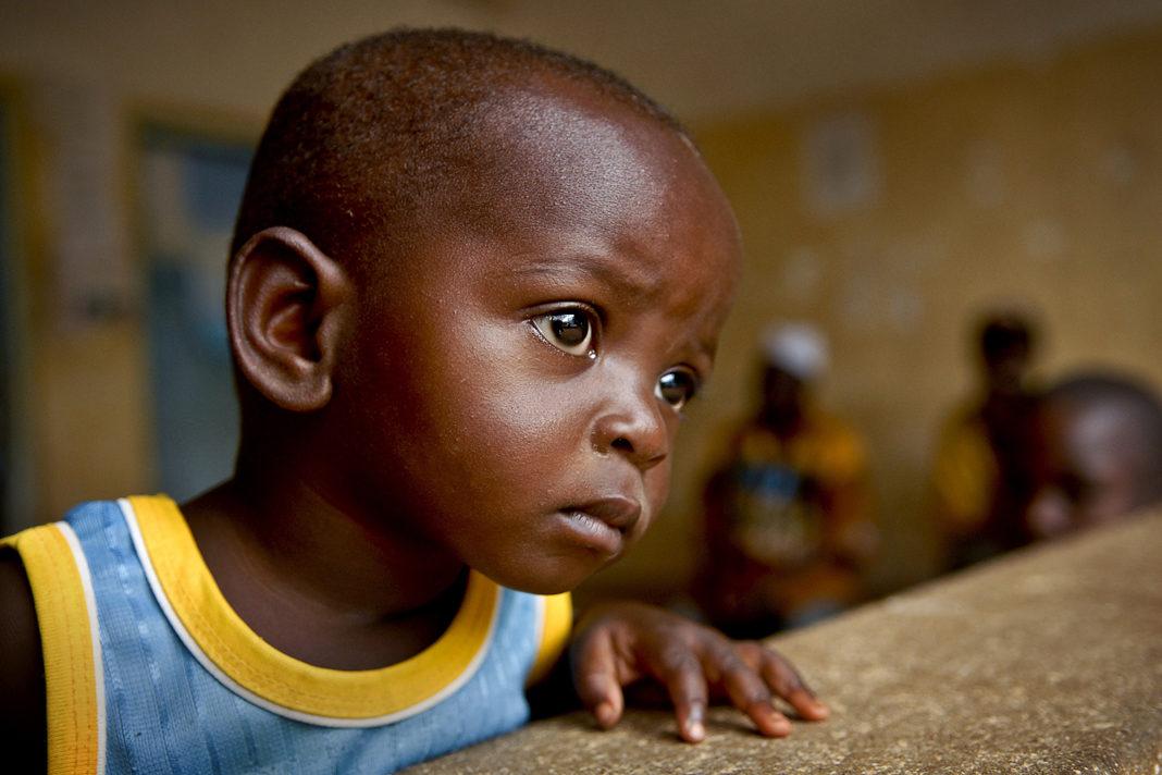 child staring at window