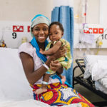 Aissata and her mother, after the surgery on the Africa Mercy. / Mercy Ships