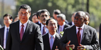 China's President Xi Jinping walks with South African President Cyril Ramaphosa