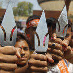 Supporters of hardline Vishwa Hindu Parishad Hindu group hold tridents in the western Indian city of Ahmedabad, India. | (PHOTO: REUTERS)