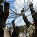 Soldiers emplace strands of concertina wire along the border fence on March 8, 2019, near Campo, Calif. (Sgt. 1st Class Ben K. Navratil/U.S. Army)
