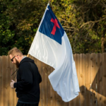 Man jogging with Christian Flag