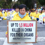 Chines woman with petition sign
