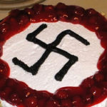 Djamel Boumaaz, an official in the French neighborhood of Montpelier, celebrated his 40th birthday with a swastika-decorated cake, July 2019. (Twitter)