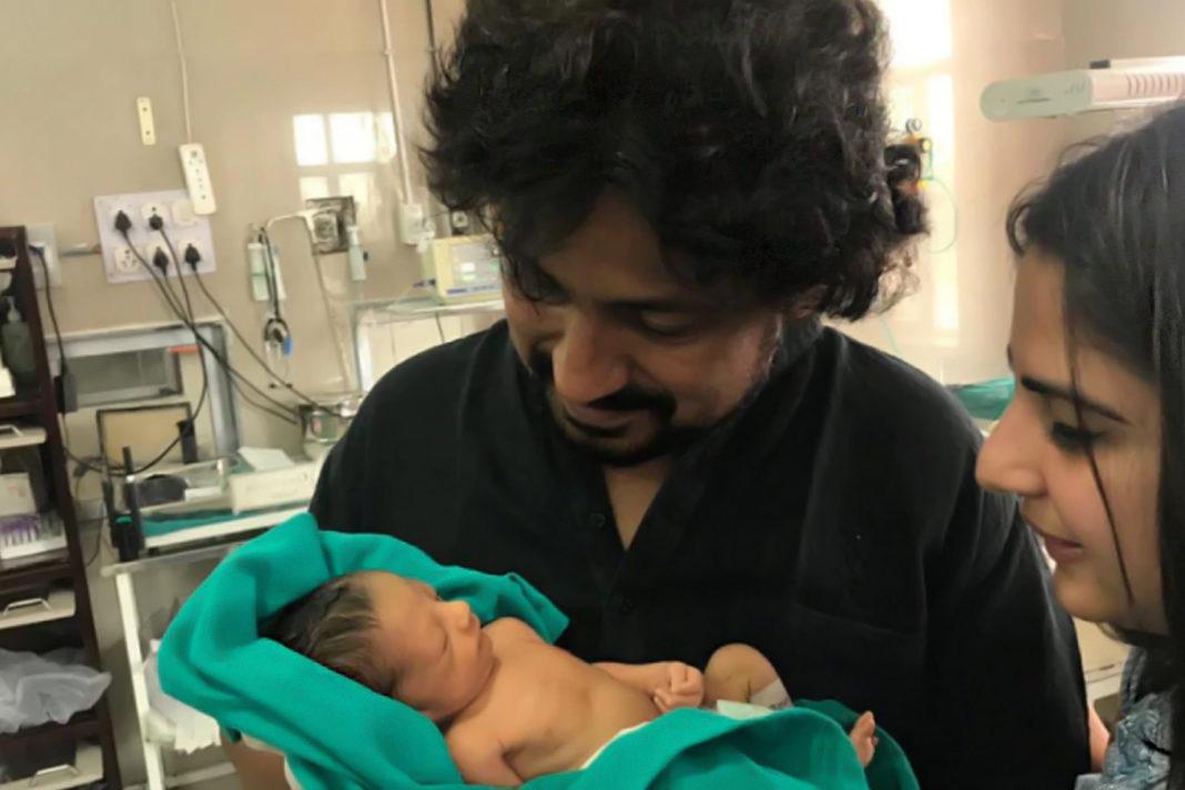 Vinod Kapri and his wife Sakshi Joshi with the baby