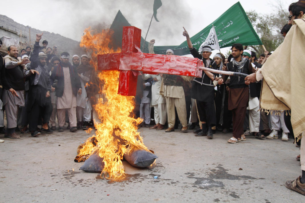People burning Cross