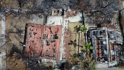 The wildfires killed 102 people and destroye hundreds od houses. / You Tube