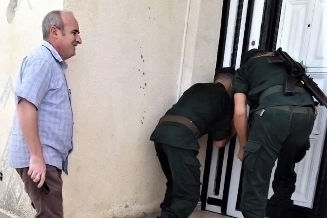 Pastor Messaoud Talkit watches as gendarmes seal church building in Lekhmis village Algeria on August 6, 2019. / Morning Star News