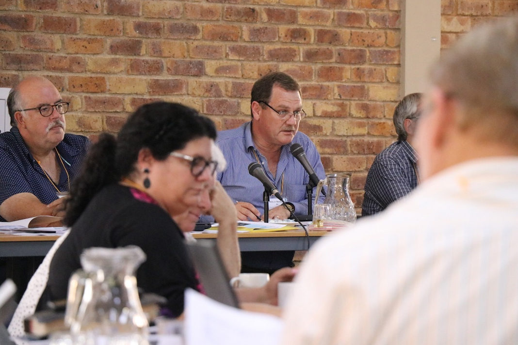 File photo of Dutch Reformed Church leaders at a general synod meeting in Kempton Park on the eve of a Hugh Court ruling in March that required the church to accept gay clergy. (PHOTO: Kerkbode).