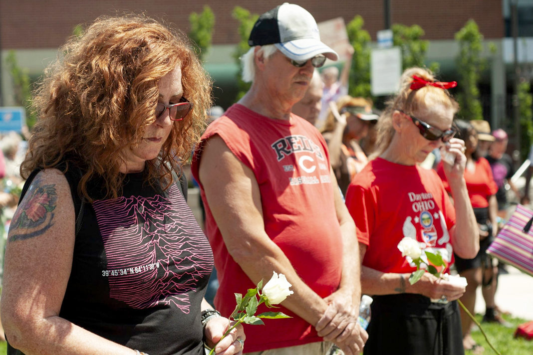 People gather for a vigil for the victims of the mass shooting that occurred over night, at the Levitt Pavilion on August 4, 2019 in Dayton, Ohio. In the second mass shooting in the U.S. within 24 hours a gunman left nine dead and another 27 wounded after only a minute of shooting. | Matthew Hatcher/Getty Images