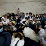 Jewish men pray at Joseph's Tomb in Shechem/Nablus