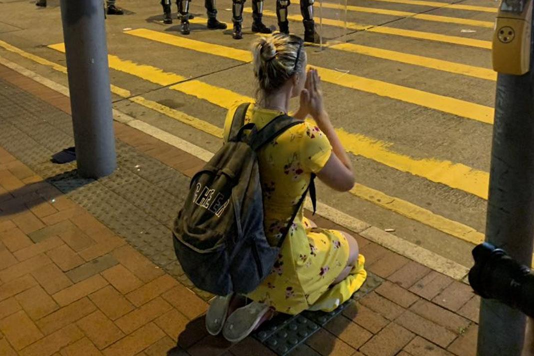 Woman praying in Hong Kong