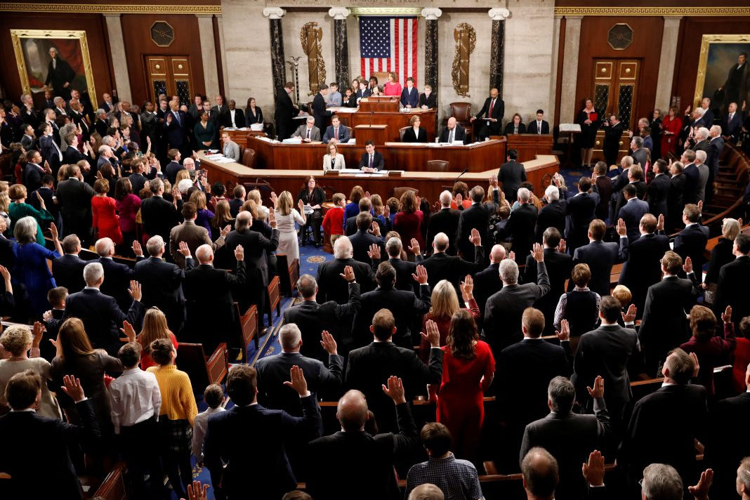 House Speaker Nancy Pelosi (D-CA) administers the oath of office to House members and delegates of the U.S. House of Representatives at the start of the 116th Congress inside the House Chamber on Capitol Hill in Washington, U.S., January 3, 2019. (photo credit: KEVIN LAMARQUE/REUTERS)
