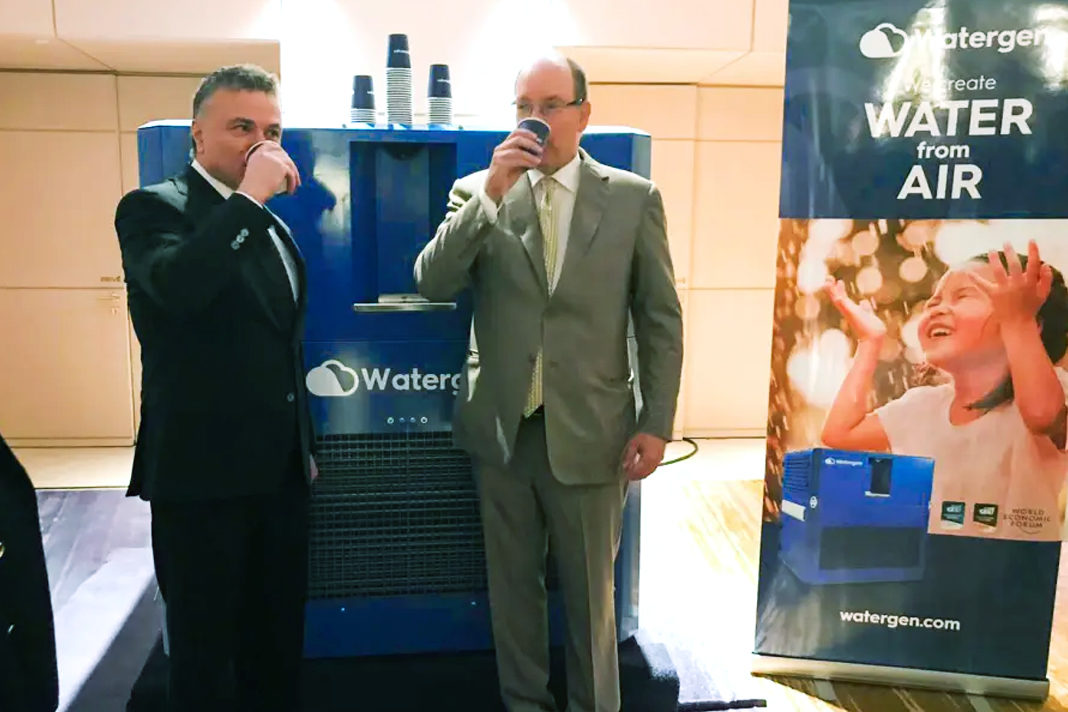 Monaco's Prince Albert II and Watergen President Michael Mirilashvili drinking water from a Watergen machine in Monaco