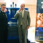 Monaco's Prince Albert II and Watergen President Michael Mirilashvili drinking water from a Watergen machine in Monaco