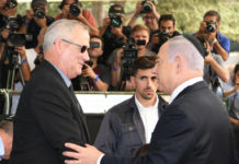 PM Benjamin Netanyahu (right) greets Blue and White party leader Benny Gantz at a memorial service for Shimon Peres in Jerusalem
