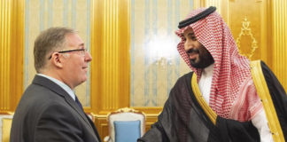 This photo provided by Embassy of the Kingdom of Saudi Arabia , dual U.S.-Israeli national Joel Rosenberg shakes hands with Crown Prince Mohamed bin Salman at a palace in Jiddah, Saudi Arabia, on Tuesday, Sept. 10, 2019. The Saudi government published photos of the meeting, which took place on Tuesday and was attended by leading American-Christian Zionist leaders, including Rosenberg. The nine-person delegation also includes Rev. Johnnie Moore, a co-chairman of President Donald Trump's Evangelical Advisory Council, and Larry Ross, once a longtime spokesman for one of America's most well-known evangelicals Billy Graham. (Embassy of the Kingdom of Saudi Arabia via AP)