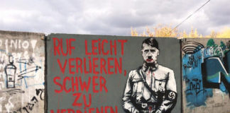 Portrait of Adolf Hitler Painted on Wall Near Grave of Holy Rabbi in Ukraine
