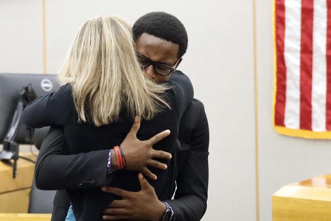 Botham Jean's younger brother, Brandt Jean, hugs former Dallas police officer Amber Guyger after delivering his victim-impact statement.