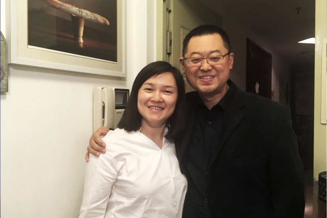 Chinese Christian Pastor Wang Yi is seen with wife Jiang Rong at their home