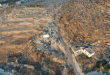 Aerial shot of junkyard on antiquities site (Courtesy of Preserving Eternity)