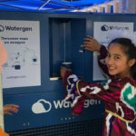 Child in Uzbekistan enjoys water thanks to Israeli startup Watergen. (Watergen)