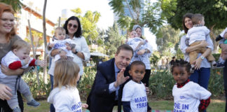 Jewish Agency Chairman Isaac Herzog with immigrants to Israel and their native-born Israeli children. Photo: courtesy