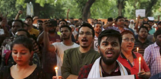 Indian protesters shout slogans as they hold placards and candles during a protest in New Delhi on June 26, 2019, condemning the recent mob lynching of a Muslim youth, Tabrez Ansari, in Jharkhand state. (AP Photo/Altaf Qadri)