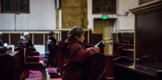 A woman prays during morning Mass Jan. 30 in the Cathedral of the Immaculate Conception in Beijing. (Credit: Roman Pilipey/EPA via CNA.)