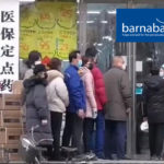 """Residents of Wuhan queue up outside a chemist shop in an attempt to buy a filter mask, now so rare they are """"worth their weight in gold"""""""