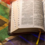 Bible and South African flag