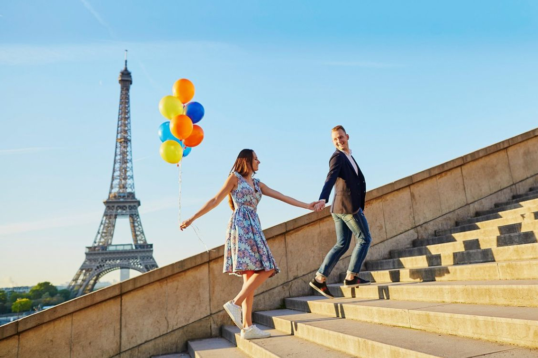 Couple walking with Eiffel tower in he background