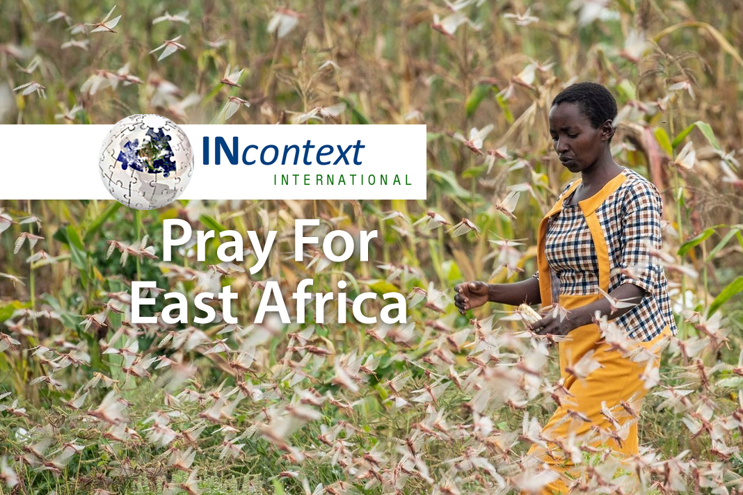 Woman in East Africa with locusts