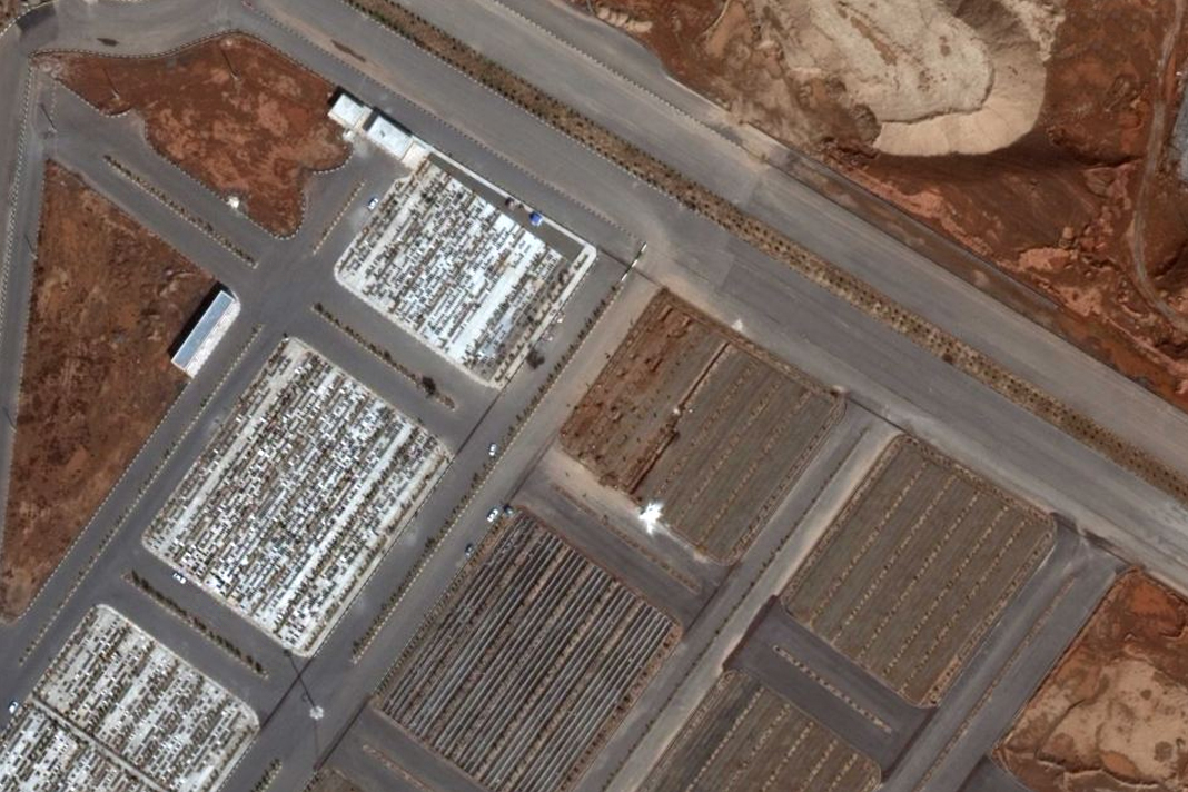 Satellite images show mass graves in Qom, Iran, early in March. (Photo: Maxar Technologies)