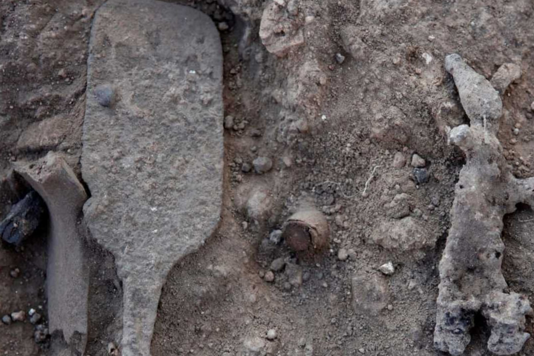 Close-up of the scepter and a smiting god figurine at the Tel Lachish archaeological dig site. (Hebrew University/Yossi Garfinkel)