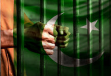 Person in prison with Pakistan flag