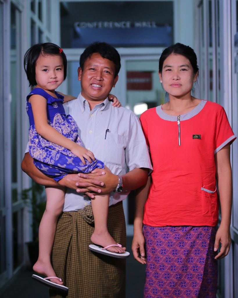 Pastor Tun reunited with his wife and one of his children. His wife had prayed relentlessly for his safe return, despite local reports that he had been killed by his kidnappers [image credit: Gospel for Asia]