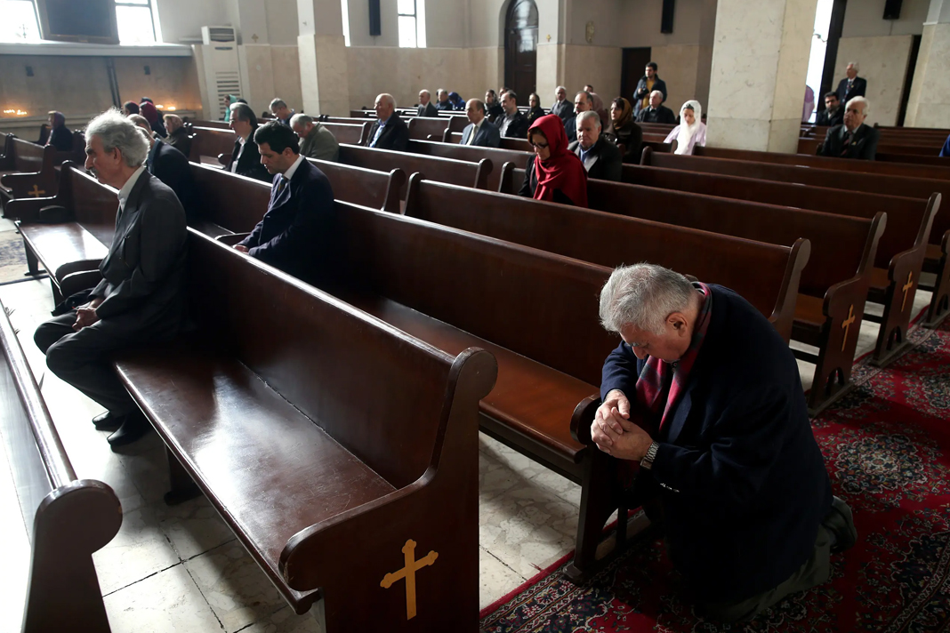 Iranian Christians pray during the New Year's mass at the Saint Sarkis church of Armenians in Tehran on Jan. 1, 2015. (AP)