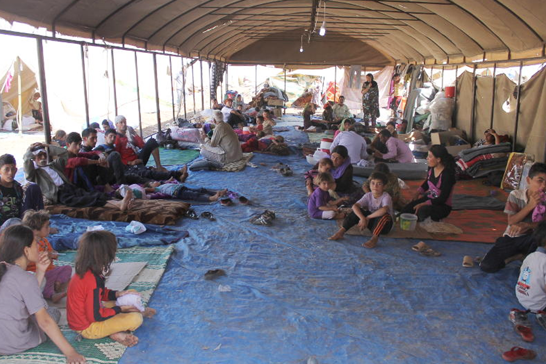 Iraqi Yazidi refugees receive help from International Rescue Committee at Newroz camp in Al-Hassakah province, north eastern Syria after fleeing Islamic State militants. Flickr/DFID - UK Department for International Development
