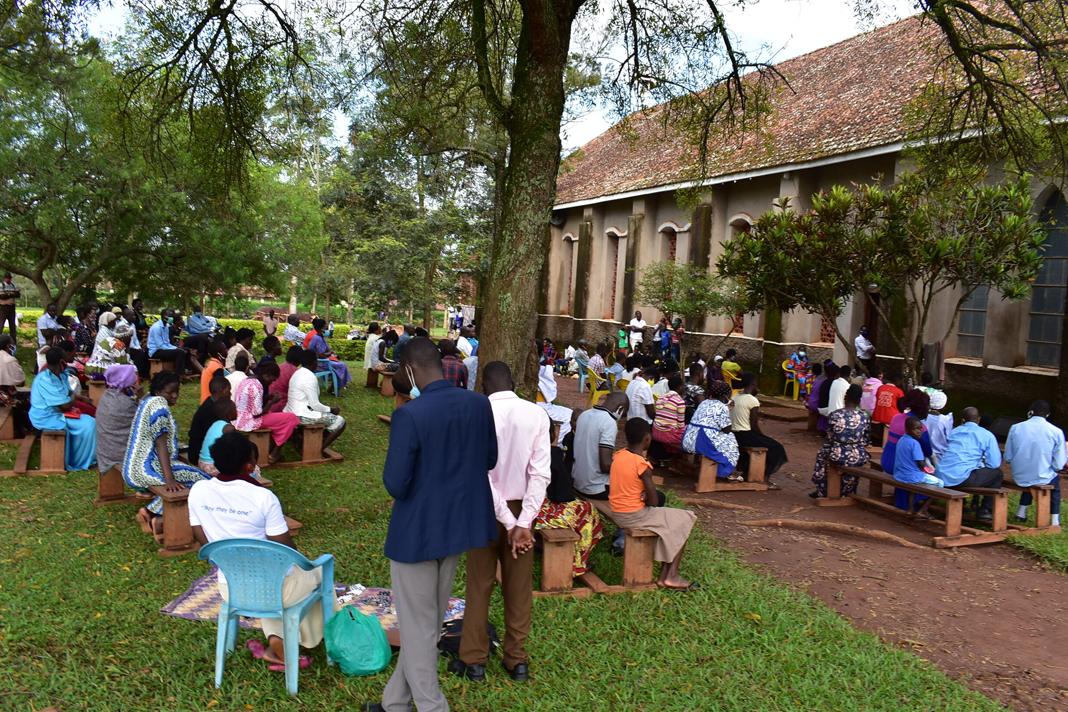 Worshippers wait to go inside for Mass at Our Lady & St. Joseph's Catholic Parish Church in Kamuli, eastern Uganda. Photo by John Semakula.