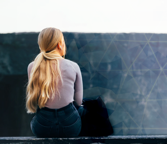 Woman sitting on wall