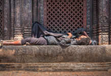 Homeless Sleeping in Front of Building